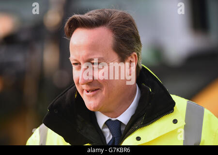 Prime Minister David Cameron views new building work at Edinburgh Airport on his making his first visit to Scotland - Stock Photo