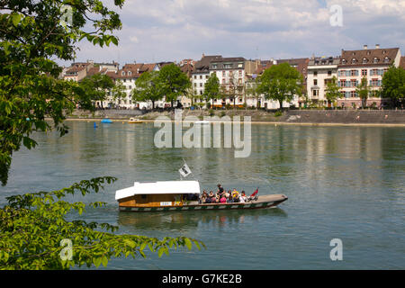 Basel straddles the Rhine at the river's farthest navigable point.  Passengers can cross it in a 'Fahrimaa,' a wooden - Stock Photo