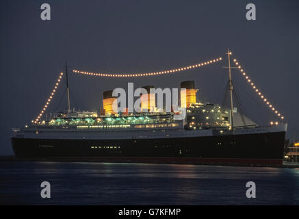 The RMS Queen Mary that began carrying passengers in 1936 as transatlantic ocean liner is now permanently docked - Stock Photo