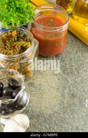 Pasta making ingredients in bowls on a stone table - Stock Photo