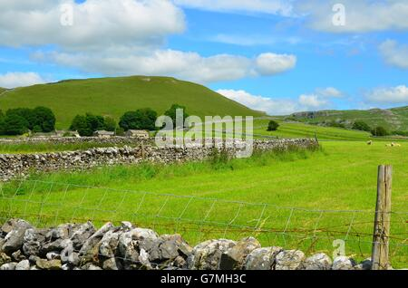 View over fields from near the limestone pavement above Malham Cove, Yorkshire Dales National Park, near Settle, West Yorkshire