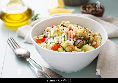 Warm couscous salad with grilled vegetables - Stock Photo