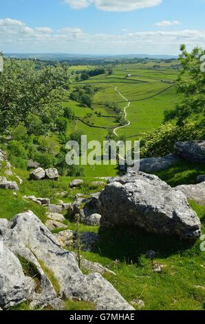 View from the limestone pavement above Malham Cove, Yorkshire Dales National Park, near Settle, West Yorkshire - Stock Photo