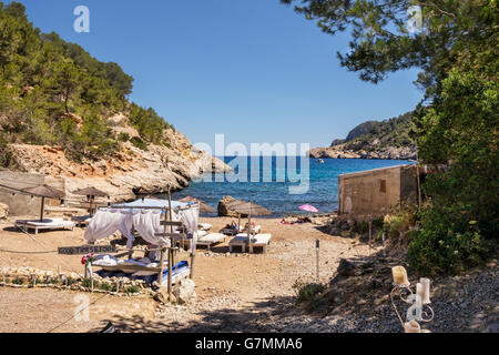 Four poster bed on beach at Puerto de San Miguel, Ibiza, Spain, - Stock Photo