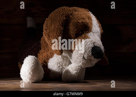 puppy toy on a wooden background. - Stock Photo