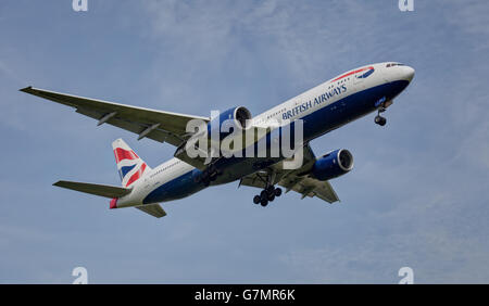 British Airways Boeing 777 G-YMMN landing at London Heathrow Airport LHR - Stock Photo