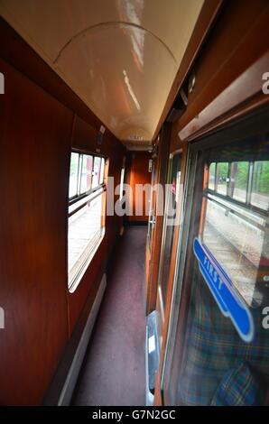 Corridor inside a vintage steam train carriage on the Strathspey steam railway Scotland - Stock Photo