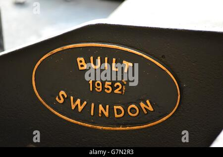 "1952 Swindon-built locomotive ""E V Cooper Engineer"" 46512, an Ivatt Class 2 2-6-0 at Aviemore, Scotland, UK sign - Stock Photo"