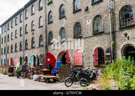 Old mill and former military building, now used as workshops in Freetown Christiania, Copenhagen.