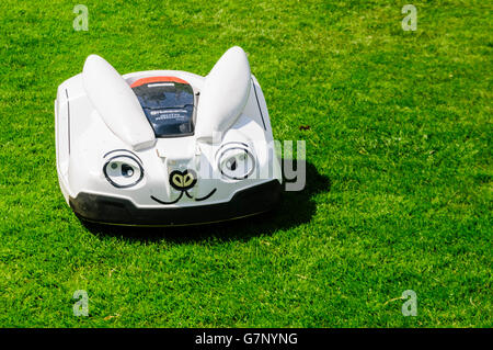 A Husqvarna robotic grass and lawn mower disguised as a rabbit. - Stock Photo