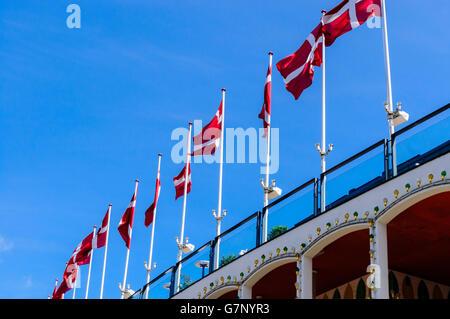 Row of Danish Flags on flagpoles - Stock Photo