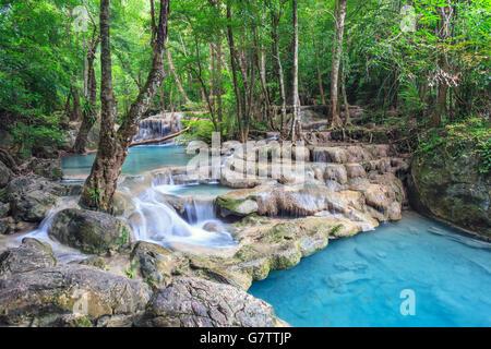 Erawan waterfall in deep forest at Kanchanaburi, Thailand - Stock Photo