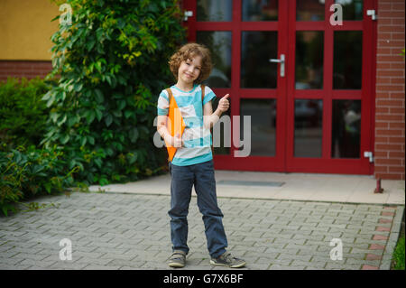 The school student rejoices to the termination of academic year and the beginning of summer vacation. Boy gesture - Stock Photo