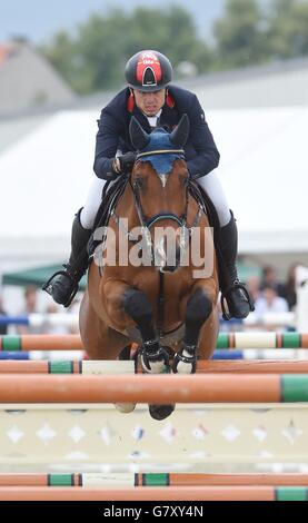 Second placed German rider Maxmilian Schmid with horse Chacon 2 during the 160 cm obstacles race during the FEI - Stock Photo