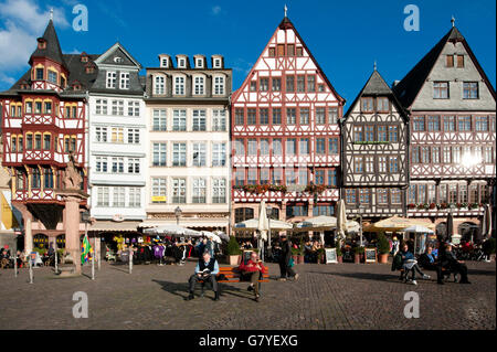 Tourists in front of the half-timbered houses on Roemerberg square, Roemer, Frankfurt am Main, Hesse - Stock Photo