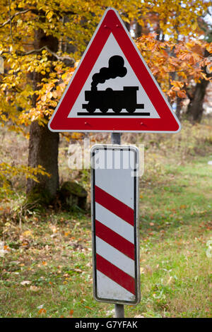 Traffic sign with a steam engine, railroad crossing, Drei-Annen-Hohne, Brocken Mountain, Harz National Park, Saxony - Stock Photo