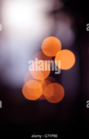 several orange bokeh with blurred circles - Stock Photo