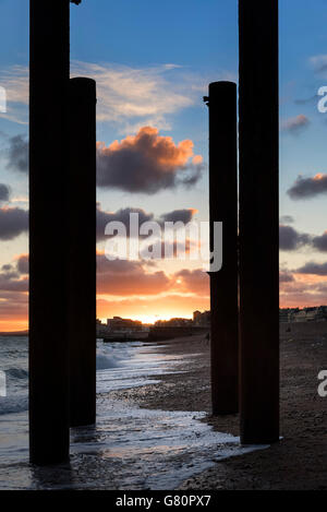 Sunset over Hove Brighton beach West Pier Sussex, England - Stock Photo