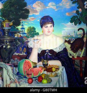 Merchant's Wife at Tea, by Boris Kustodiev, 1918, State Russian Museum, Saint Petersburg, Russia - Stock Photo