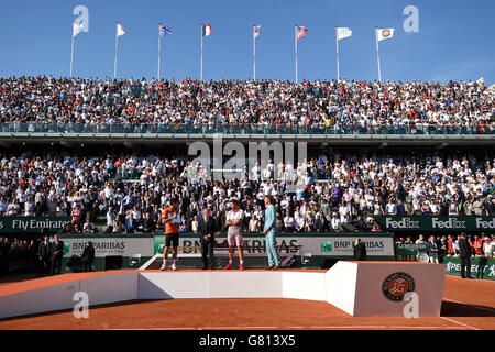 Trophy presentation after the men's singles final with Novak Djokovic, French Tennis Federation (FFT) President Jean Gachassin, Stan Wawrinka and Gustavo Kuerten on day fifteen of the French Open at Roland Garros on June 7th, 2015 in Paris, France
