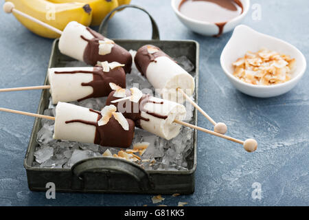 Banana and chocolate popsicles - Stock Photo