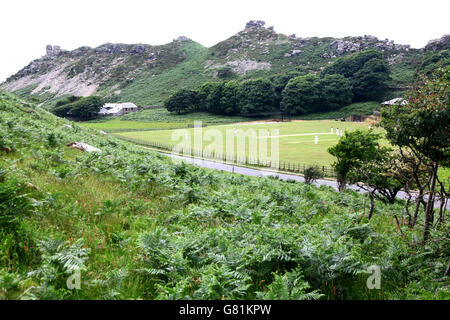 A cricket match in progress in 'The Valley of the Rocks', a famous tourist spot near Lynton in North Devon, England - Stock Photo