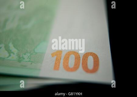 Three green one hundred European Euro bank notes, 14 November 2007. - Stock Photo