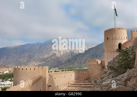Watch tower of an ancient fort in oman against the backdrop of a blue sky - Stock Photo