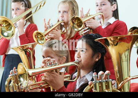 Group Of Students Playing In School Orchestra Together - Stock Photo
