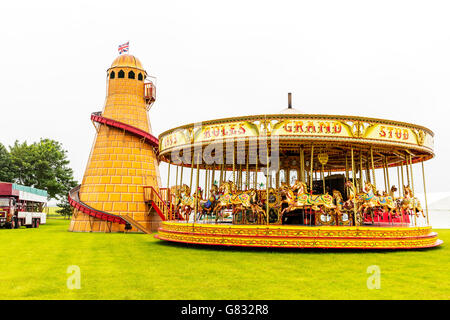 Helter skelter merry go round fair fairground rides ride attraction attractions fairs UK England GB