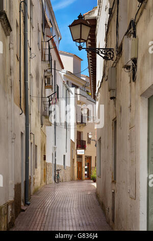 Beautiful narrow street in Tossa de Mar, Spain, on May 24, 2016 - Stock Photo