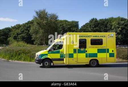 NHS Northwest Emergency ambulance on roundabout in Southport, Merseyside, UK - Stock Photo