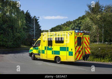 NHS Emergency North west ambulance srviceon roundabout in Southport, Merseyside, UK - Stock Photo