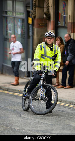 A Police officer patrolling on a bicycle in Selkirk in the Scottish Borders.