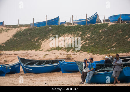 Fishing boats ashore in Tifnit beach near Agadir, Morocco. - Stock Photo