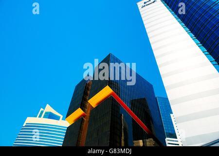 City centre Doha, Qatar. Towers line Majlis Al Taawon Street. L-R Qatar Petroleum District, Golden Bay Tower and - Stock Photo