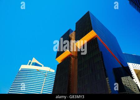 City centre Doha, Qatar. Towers line Majlis Al Taawon Street. Left Qatar Petroleum District Tower. Right Golden - Stock Photo