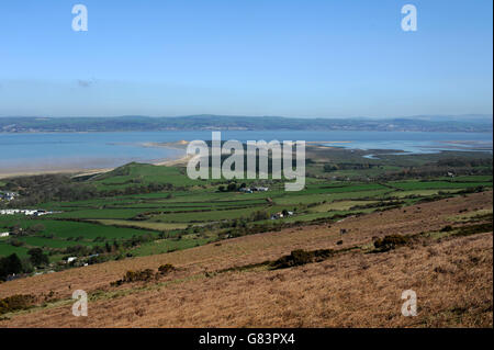 view over Whiteford point  bracken and green fields with the Loughor estuary , woodland and Llanelli on horizon - Stock Photo