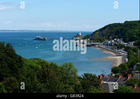 Mumbles at high tide with bay and village, lighthouse and lifeboat station on pier, Swansea Bay site of Tidal Lagoon - Stock Photo