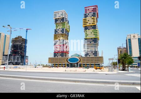 "Rapidly developing new city of Lusail, Qatar. The colourful Twin Towers high rise aka ""Building Blocks"" in the Marina - Stock Photo"