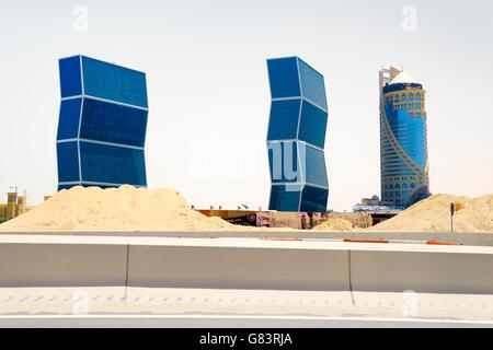 "Rapidly developing new city of Lusail, Qatar. West Bay Lagoon Plaza ""Zig-Zag"" residential towers (L) and the Falcon - Stock Photo"