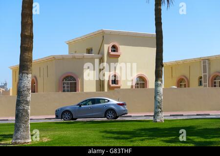 Rapidly developing new city of Lusail, Qatar. One of many private residential homes houses apartments in the West - Stock Photo