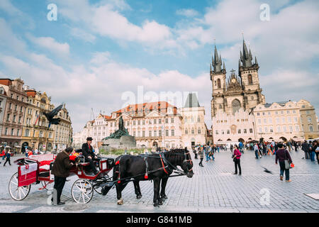 Prague, Czech Republic - October 13, 2014: Old-fashioned Coach And Coachman At The Old Town Square - Stock Photo