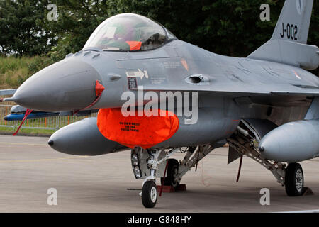 LEEUWARDEN, NETHERLANDS - JUNI 11 2016 F16 fighter jet during the air show in Leeuwarden. people can see the planes - Stock Photo