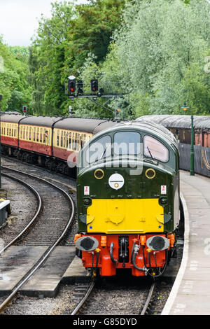 Class 40 D213 Andania heading a passenger train into Pickering station on the North Yorks Moors Railway - Stock Photo