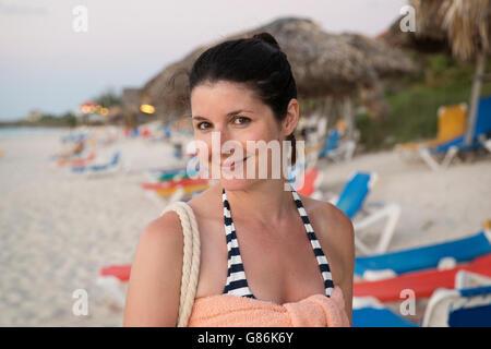Woman posing on a tropical beach - Stock Photo