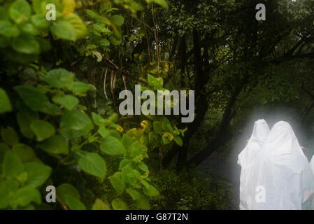 Visitors of the Victoria Falls wearing raincoats in Livingstone, Zambia - Stock Photo