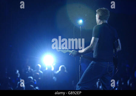 Bryan Adams performing live on stage at the Birmingham LG Arena ...
