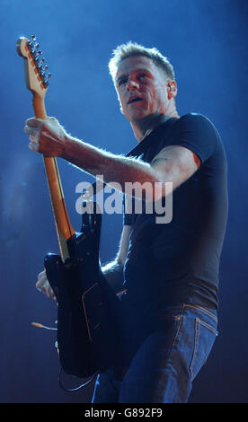 Bryan Adams performs on stage during a concert in Cologne, Germany ...