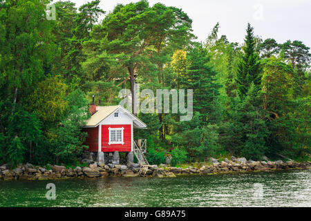 Red Finnish Wooden Sauna Log Cabin On Island In Summer - Stock Photo